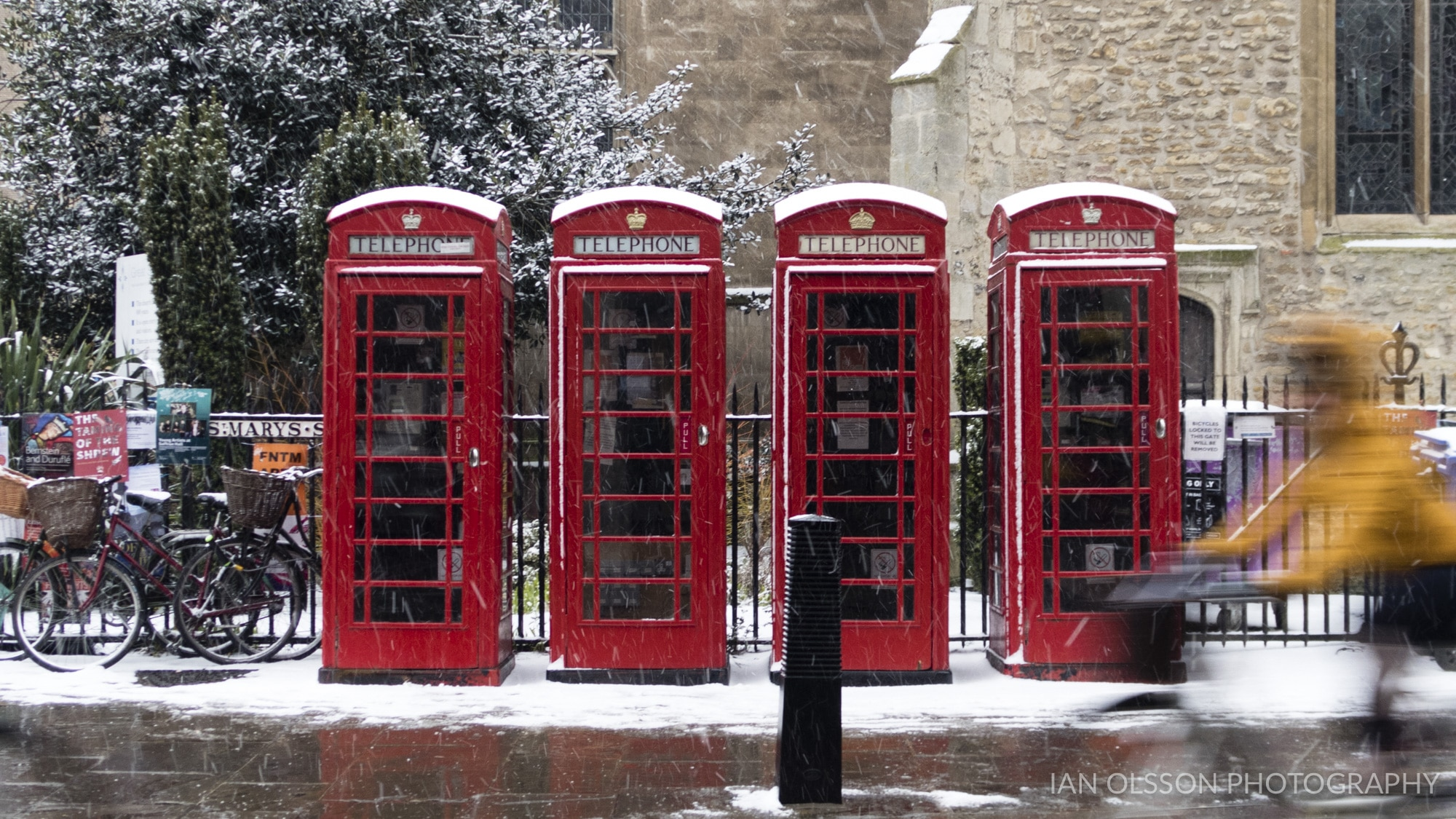 Phone Boxes and cyclist in the Snow on St Mary's Street Cambridge